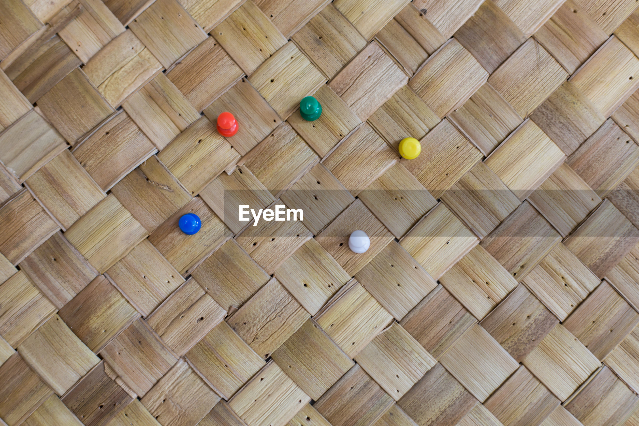 Full frame shot of wicker with colorful thumbtacks