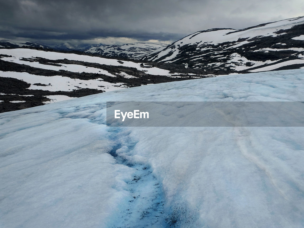 glacier in Breheimen National Park in Norway where you can experience barren mountains, streaming rivers, opalescent glaciers and rough untouched nature. Breheimen National Park Norway The Great Outdoors - 2018 EyeEm Awards Beauty In Nature Cold Temperature Environment Frozen Glacier Ice Landscape Nature No People Non-urban Scene Norway Nature Outdoor Photography Outdoors Remote Snow Tranquility White Color Wilderness