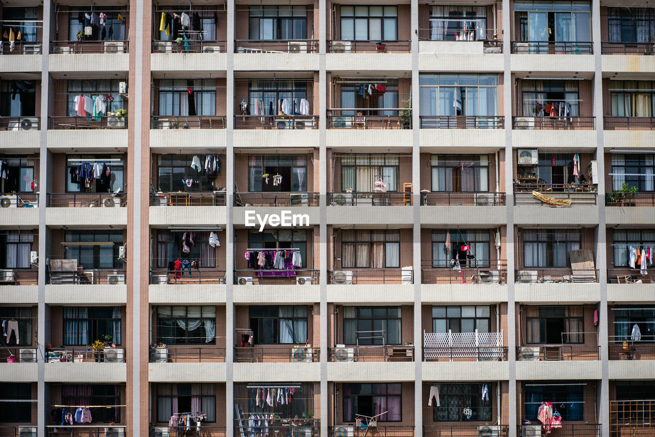 architecture, building exterior, window, built structure, full frame, backgrounds, building, balcony, no people, city, in a row, day, residential district, apartment, side by side, outdoors, low angle view, nature, pattern