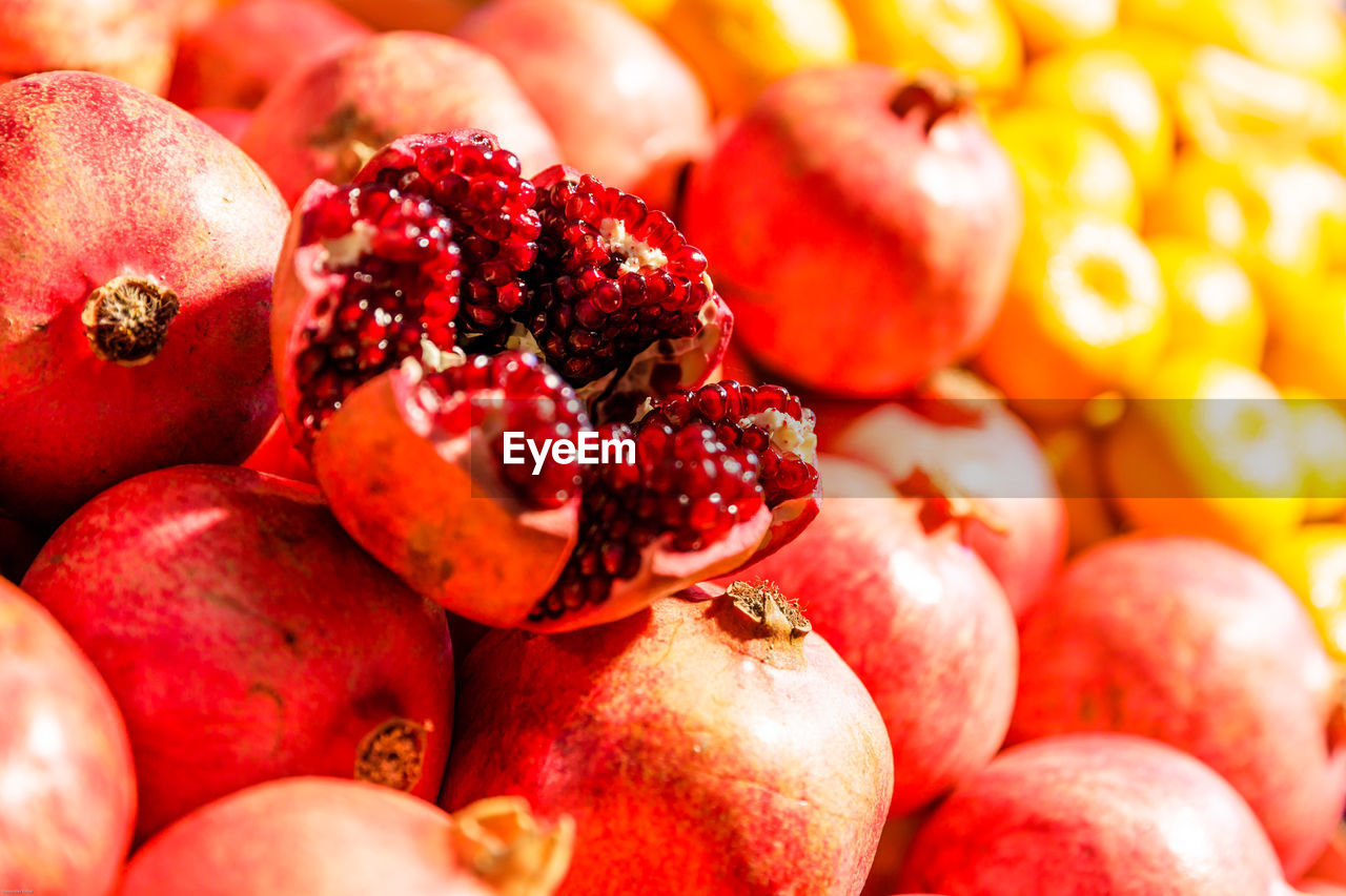 food and drink, healthy eating, food, wellbeing, freshness, fruit, red, close-up, full frame, no people, still life, large group of objects, backgrounds, pomegranate, day, for sale, group of objects, market, organic, selective focus, ripe