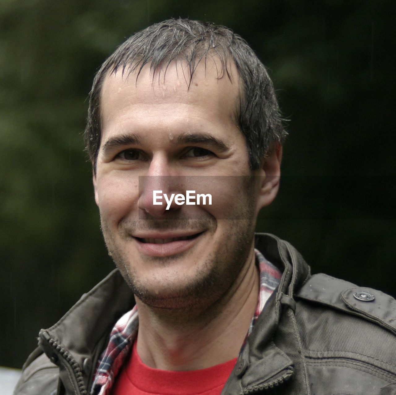 Portrait Of Wet Man Smiling Outdoors