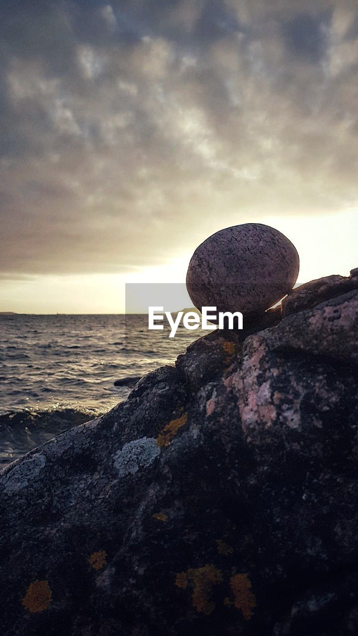 rock - object, sky, sea, beauty in nature, nature, rock, cloud - sky, rock formation, sunset, scenics, tranquil scene, tranquility, water, no people, horizon over water, outdoors, beach, day