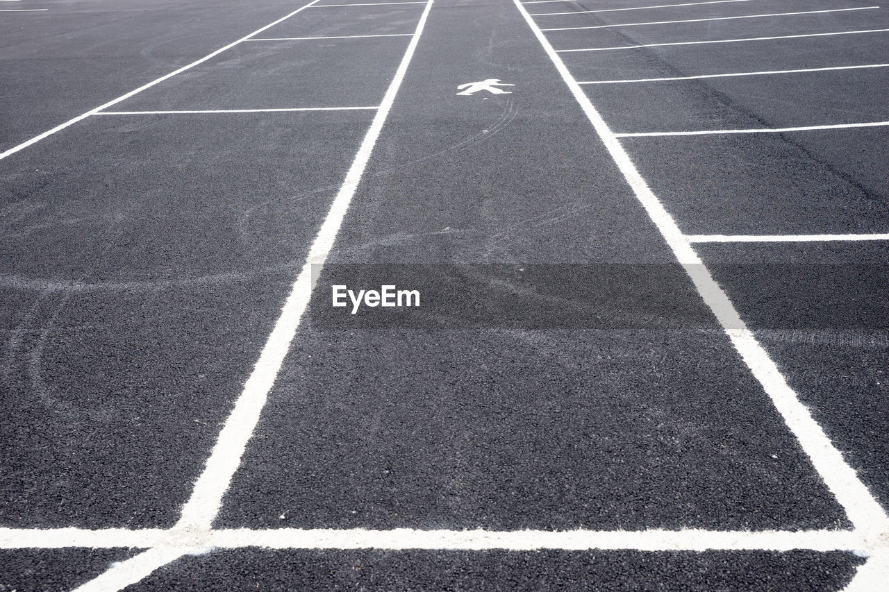 High angle view of markings at parking lot