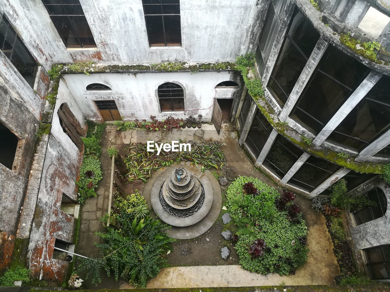 architecture, built structure, building exterior, building, no people, abandoned, day, window, old, low angle view, staircase, outdoors, damaged, water, plant, nature, weathered, run-down, courtyard, ruined