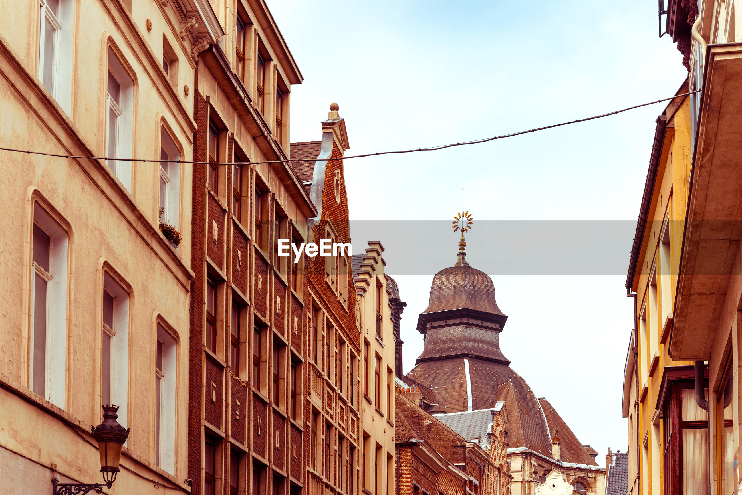 Low angle view of church by buildings in city