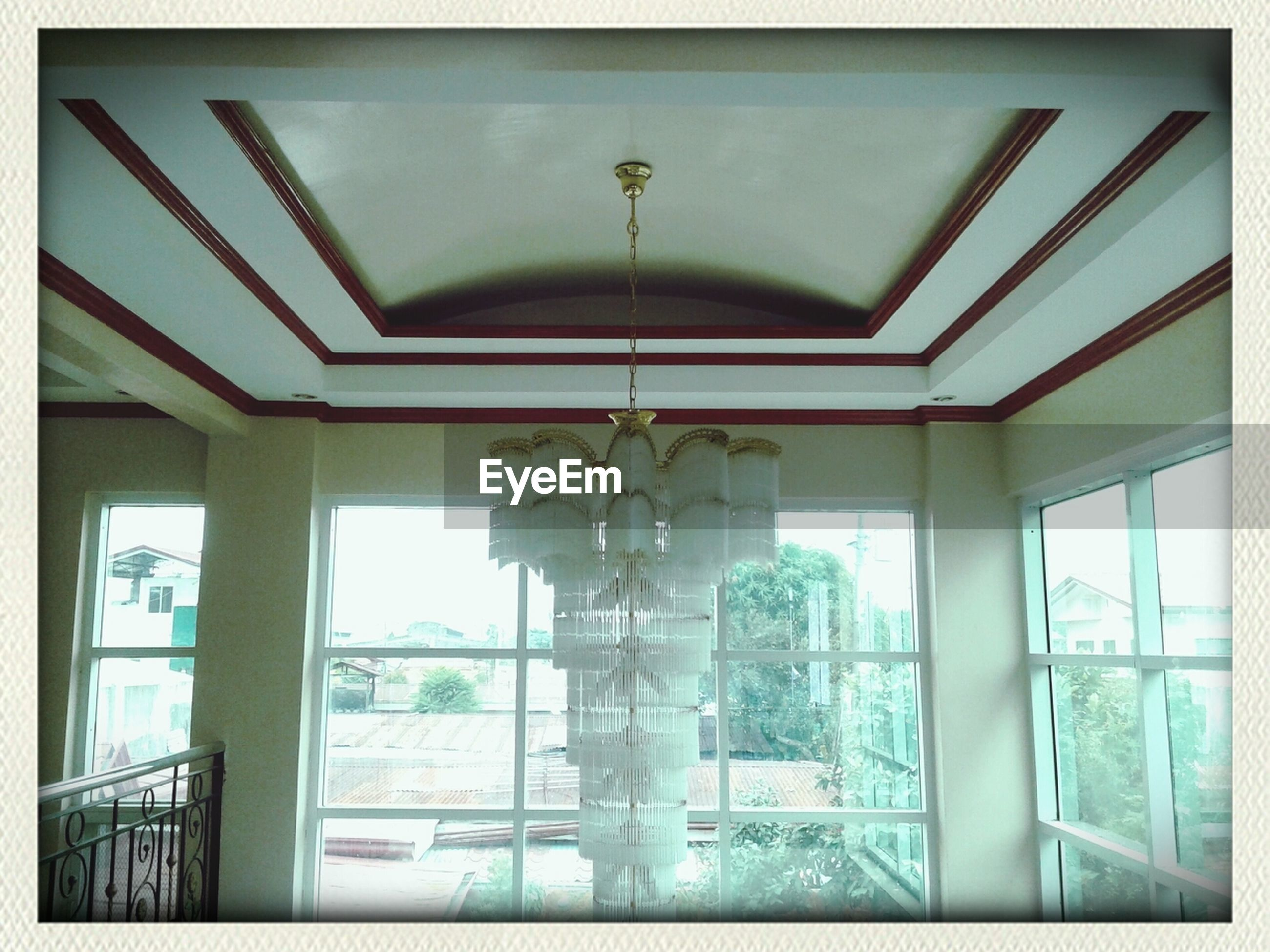indoors, ceiling, architecture, built structure, window, transfer print, glass - material, low angle view, interior, auto post production filter, architectural feature, door, pattern, day, arch, building, transparent, no people, hanging, corridor