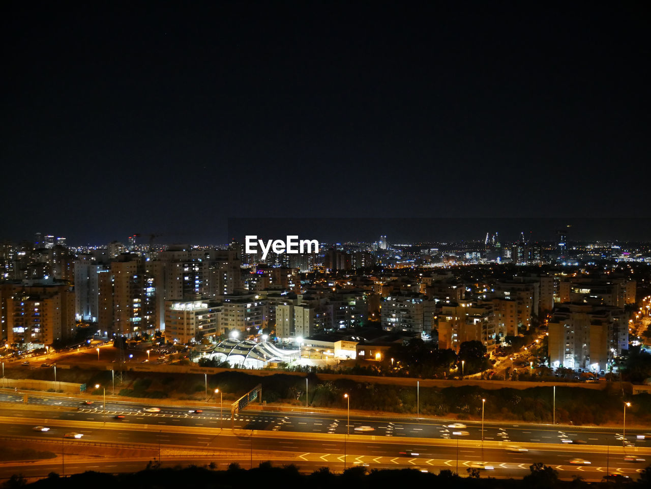 illuminated, city, night, architecture, building exterior, built structure, cityscape, building, no people, copy space, residential district, sky, modern, outdoors, nature, street, urban skyline, vitality, clear sky, office building exterior, skyscraper
