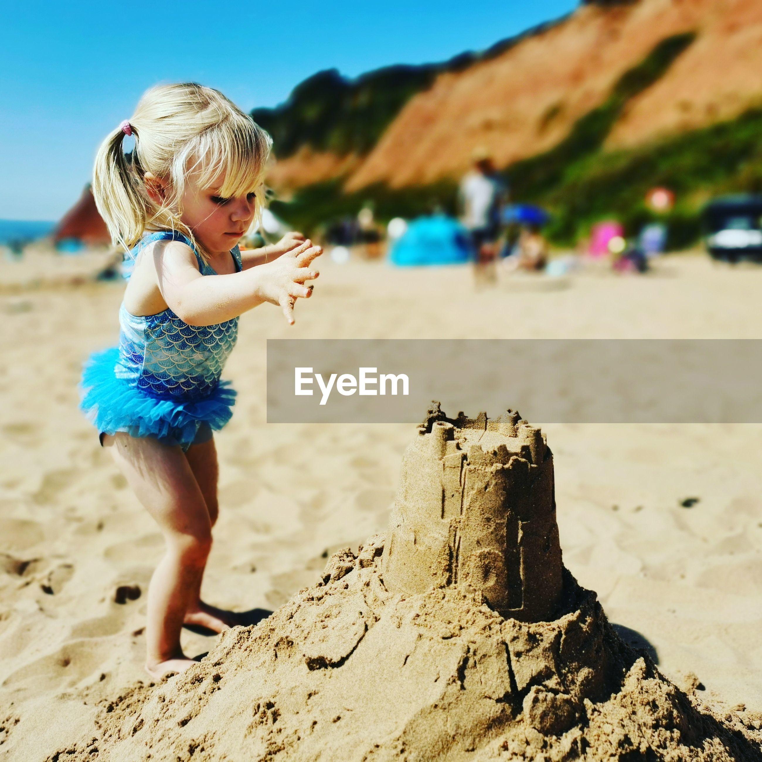 Full length of girl on sand at beach