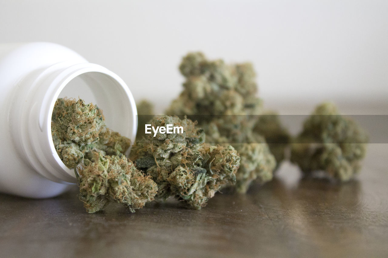 medicine, healthcare and medicine, marijuana - herbal cannabis, herb, herbal medicine, indoors, cannabis plant, table, food and drink, close-up, still life, selective focus, plant, alternative medicine, narcotic, container, food, no people, medical cannabis, recreational drug