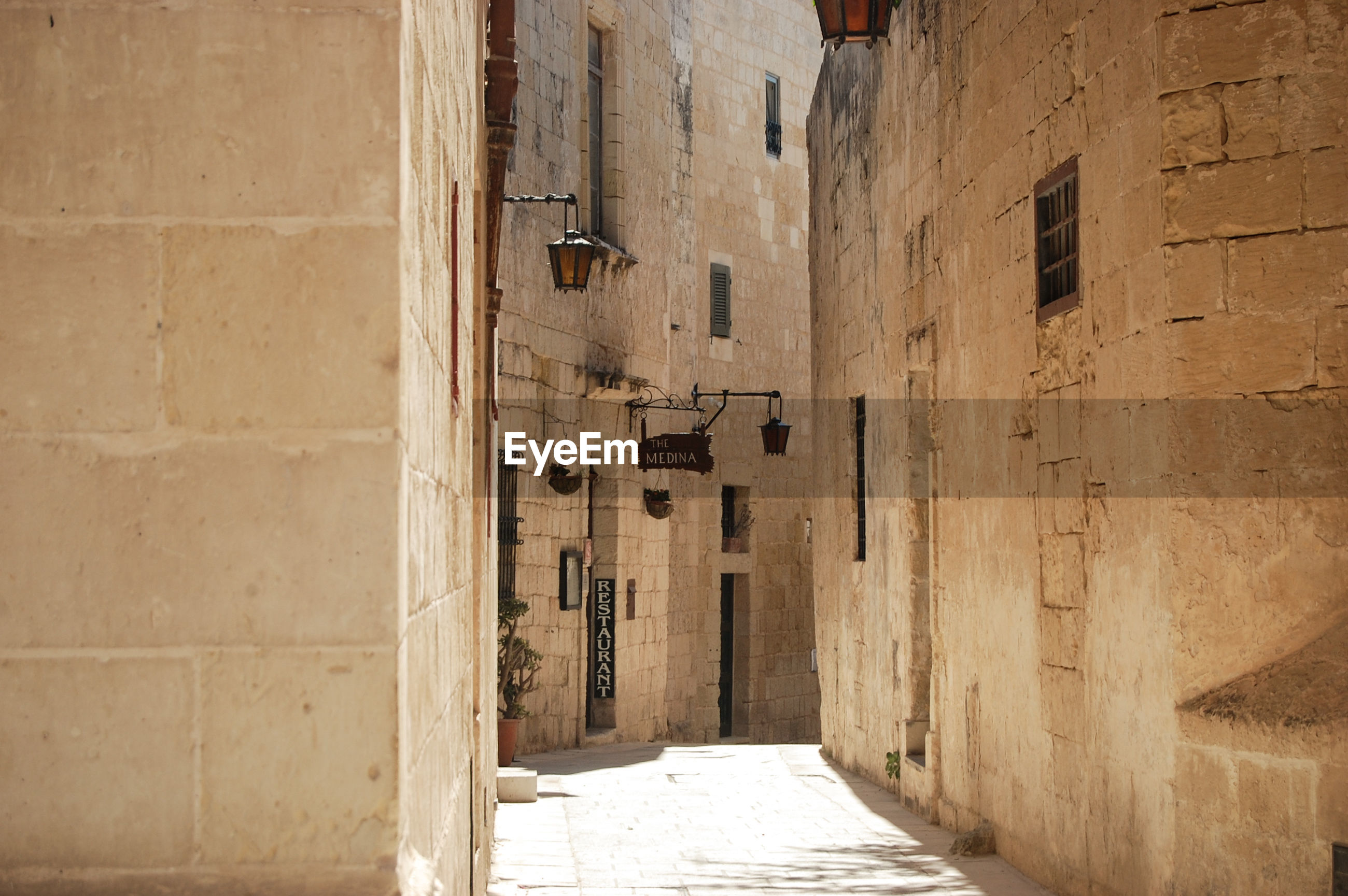 NARROW ALLEY AMIDST OLD BUILDINGS