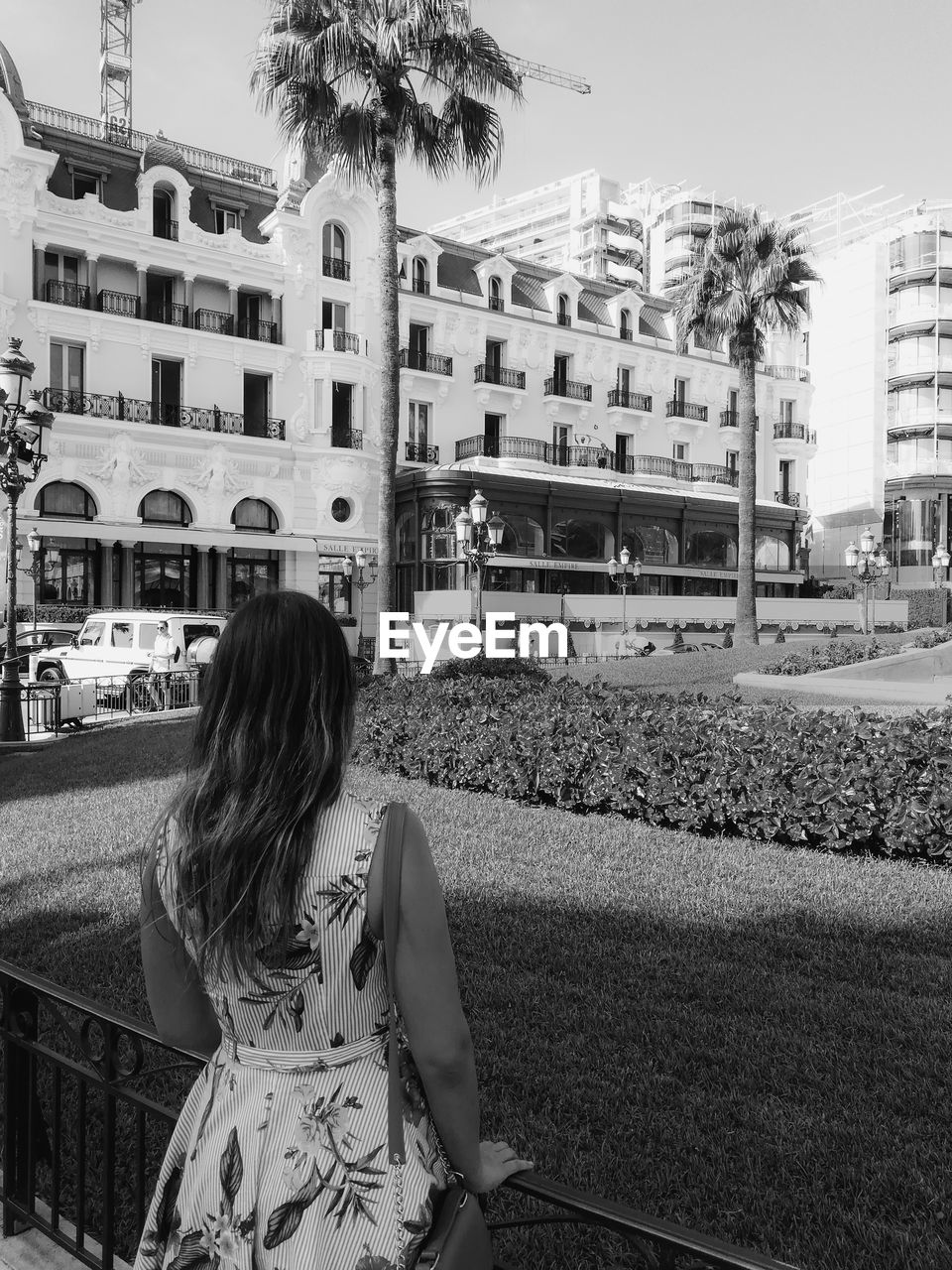 Rear view of woman looking at buildings