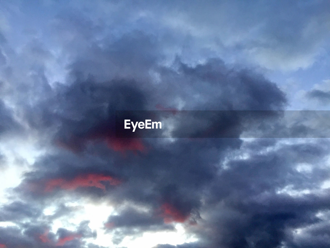 cloud - sky, weather, sky, low angle view, beauty in nature, no people, nature, cloudscape, dramatic sky, backgrounds, outdoors, sky only, storm cloud, multi colored, scenics, day