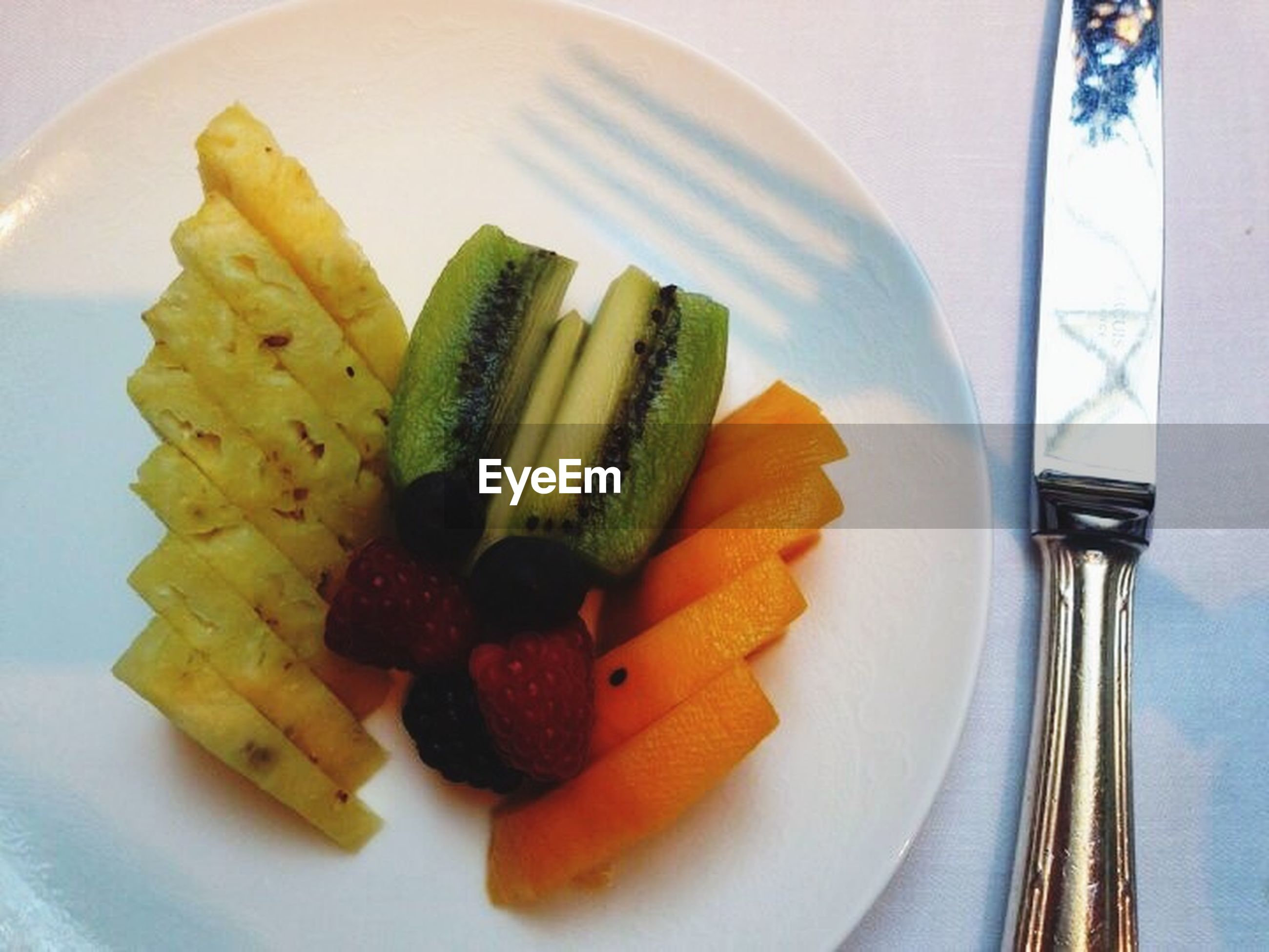 food and drink, food, indoors, freshness, plate, still life, healthy eating, ready-to-eat, table, fork, slice, fruit, high angle view, close-up, serving size, breakfast, indulgence, directly above, meal, bowl