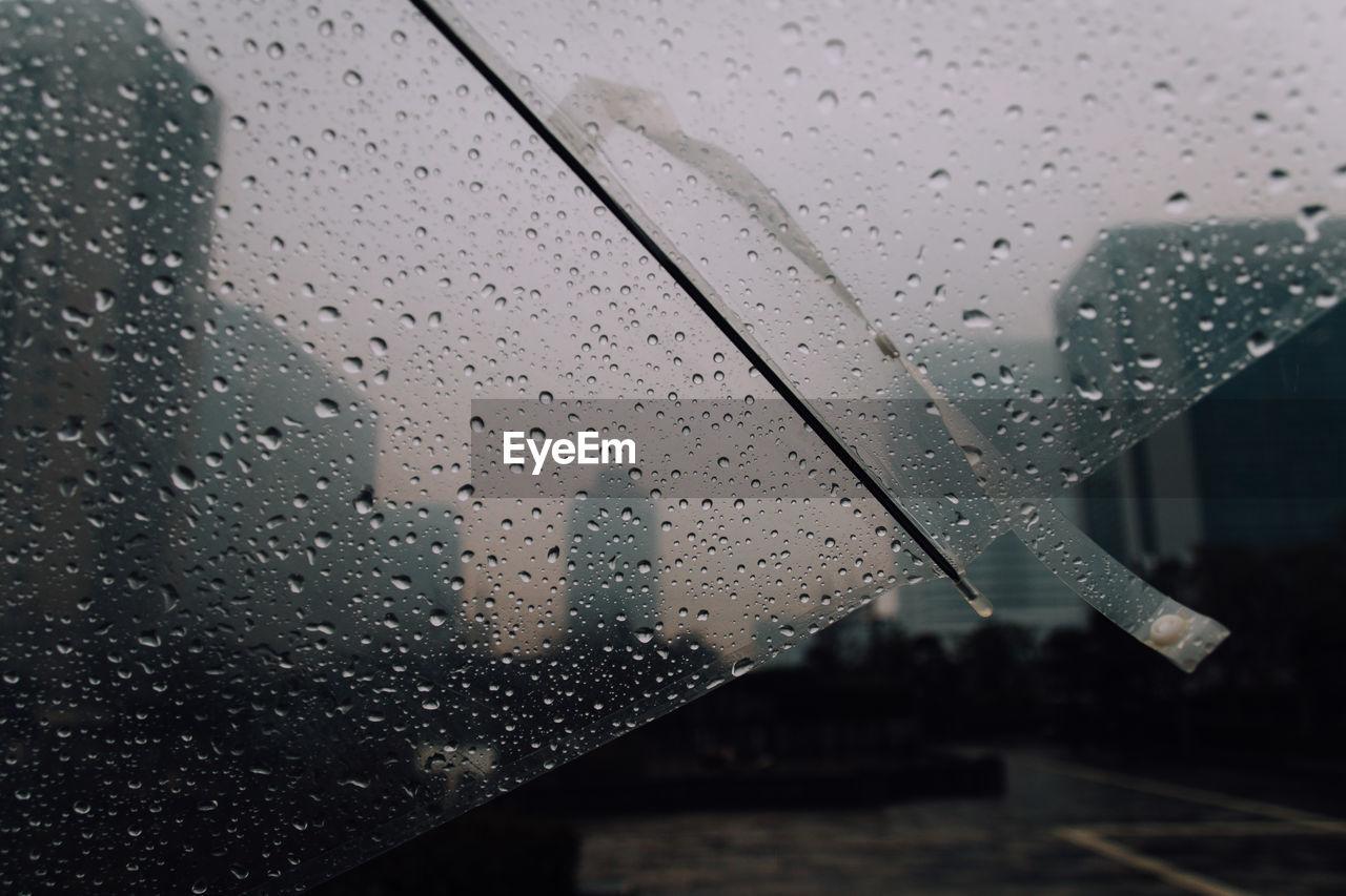 Close-Up Of Raindrops On Umbrella During Monsoon