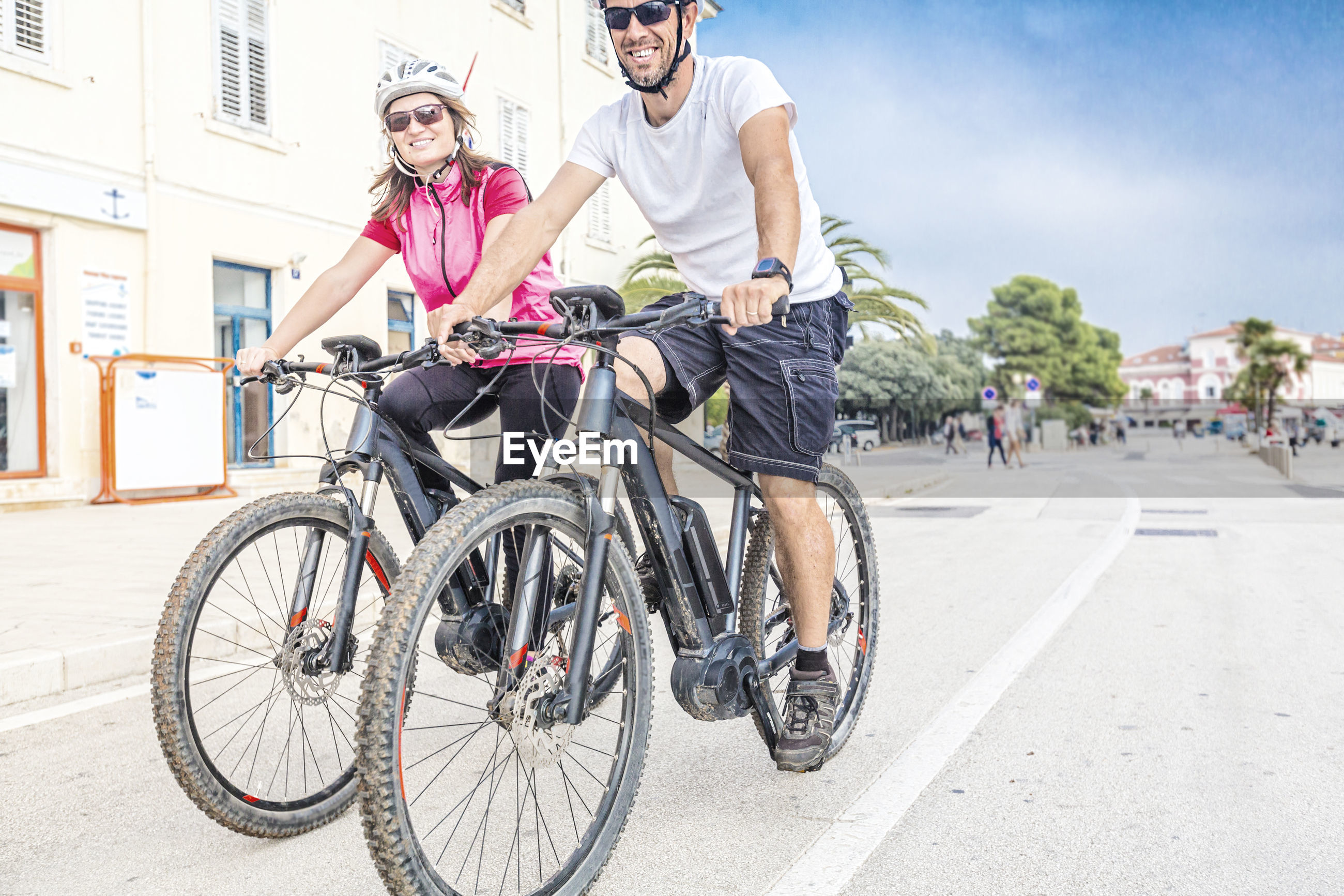 Friends riding bicycle