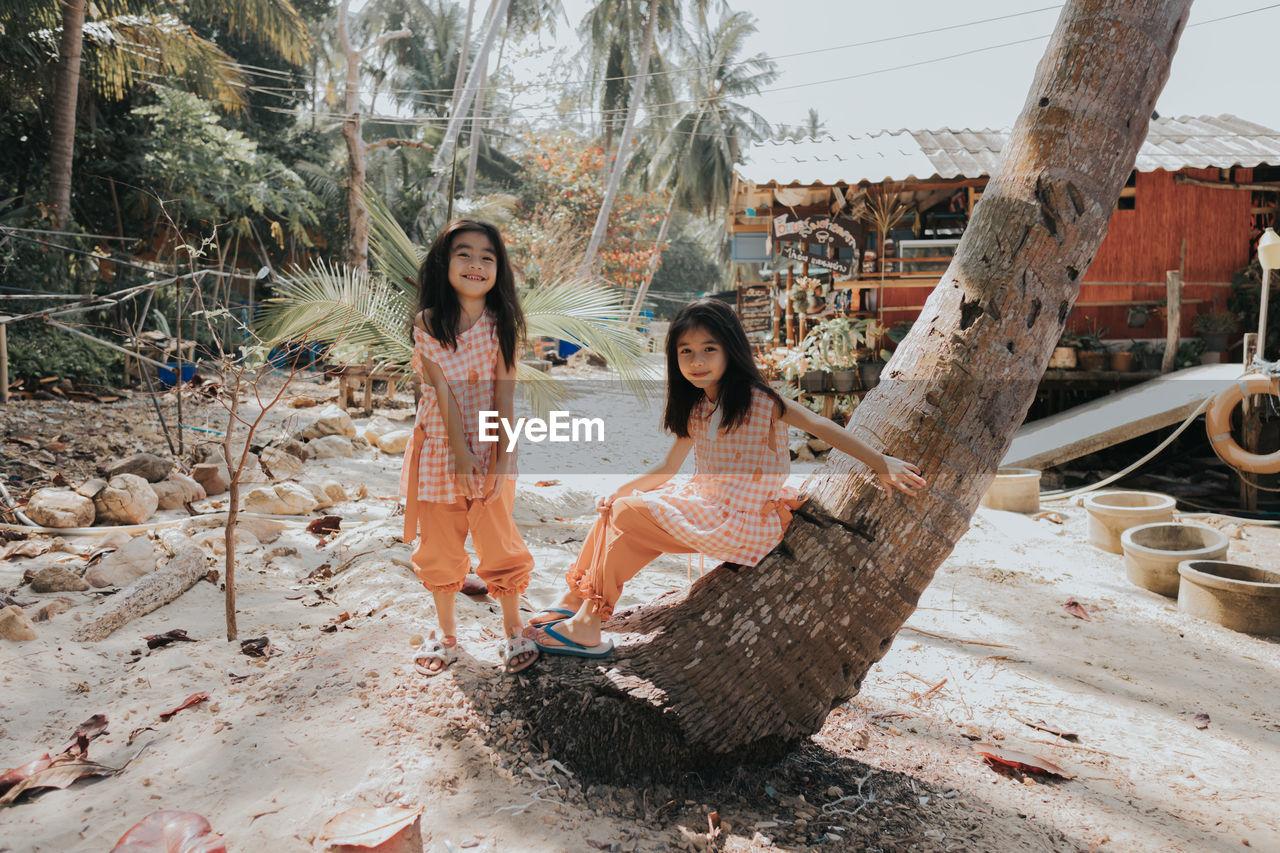 Women sitting on tree trunk