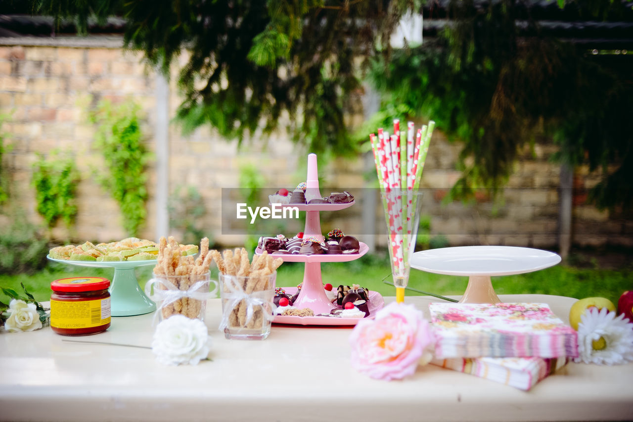 table, food and drink, sweet food, no people, focus on foreground, cake, day, dessert, outdoors, food, freshness, close-up, ready-to-eat