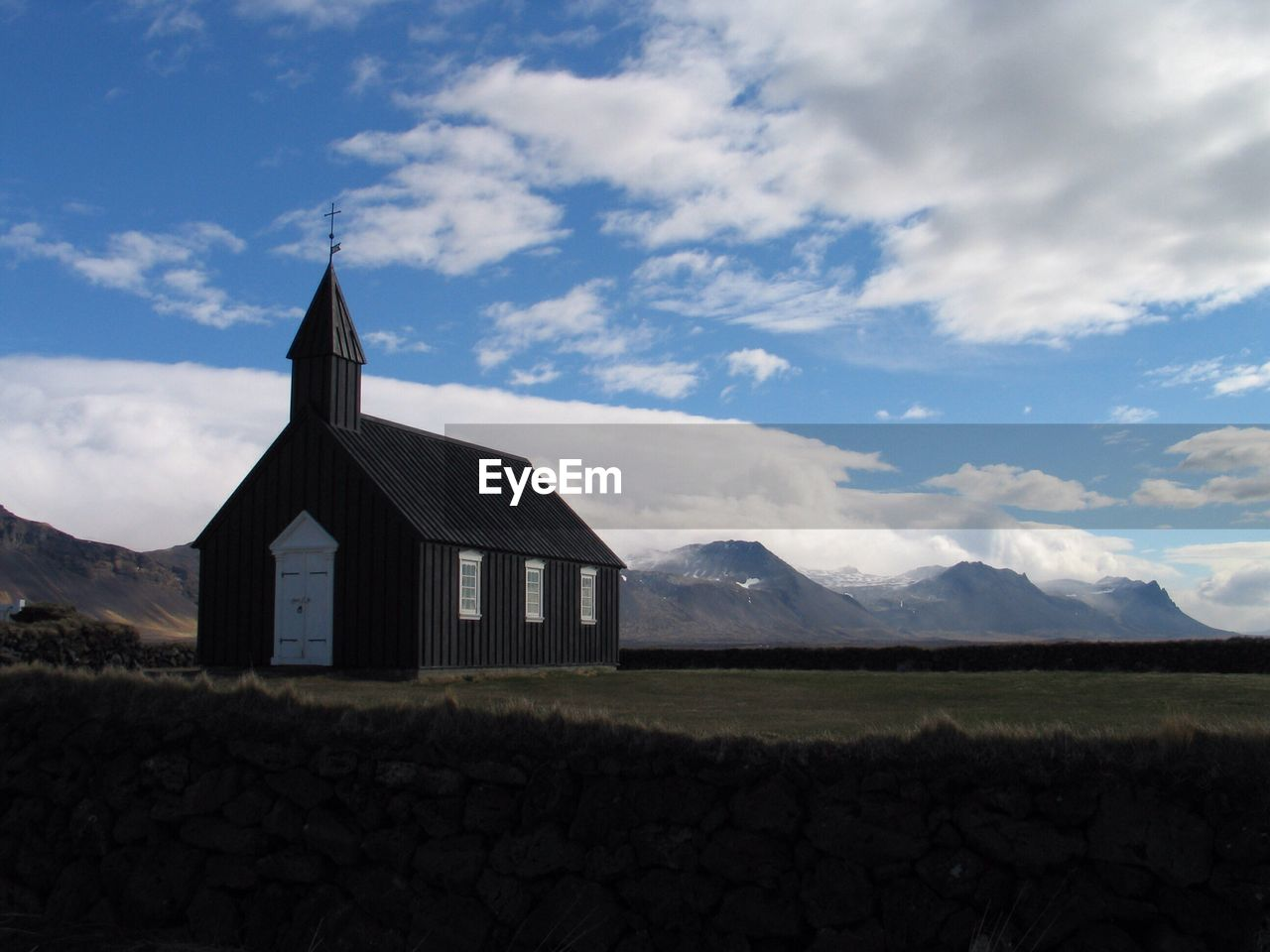 Scenic View Of Church Against Cloudy Sky