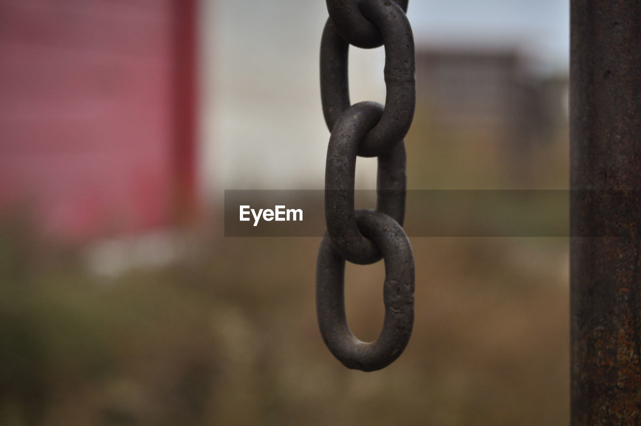 metal, focus on foreground, chain, close-up, strength, no people, selective focus, day, connection, outdoors, security, safety, hanging, iron - metal, solid, rusty, shape, single object, pattern, silhouette, iron