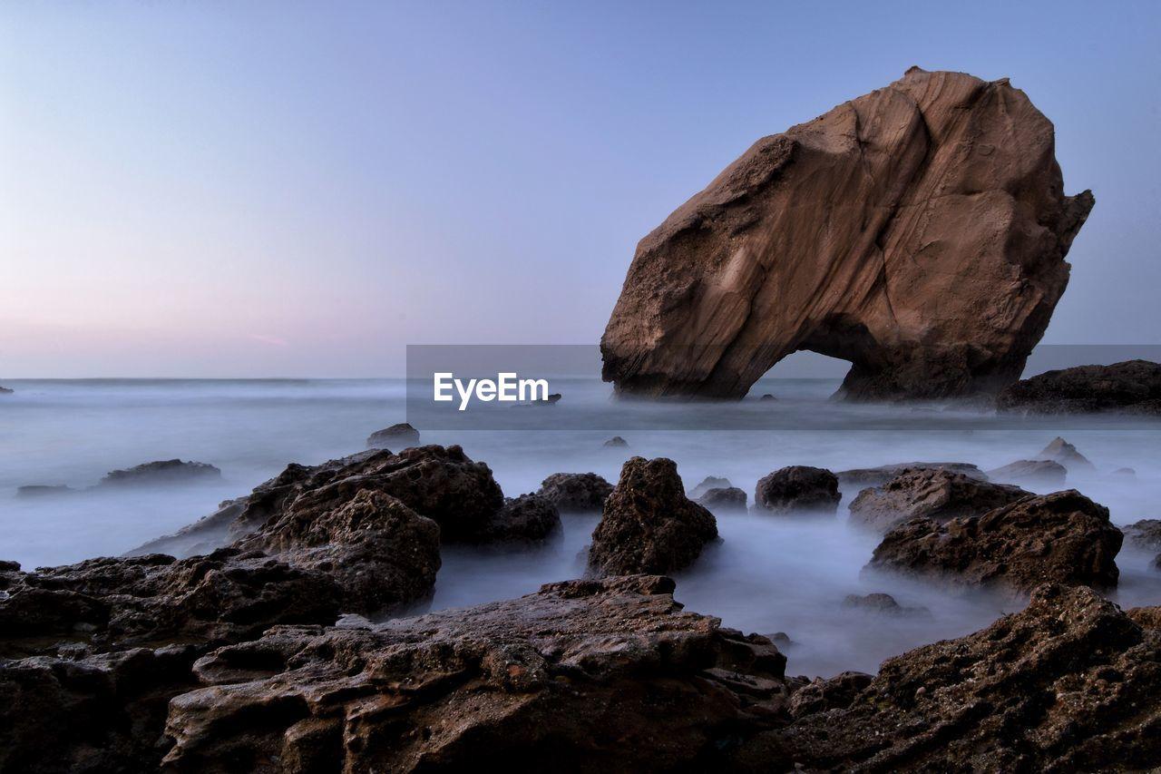 Scenic view of rocks on seashore