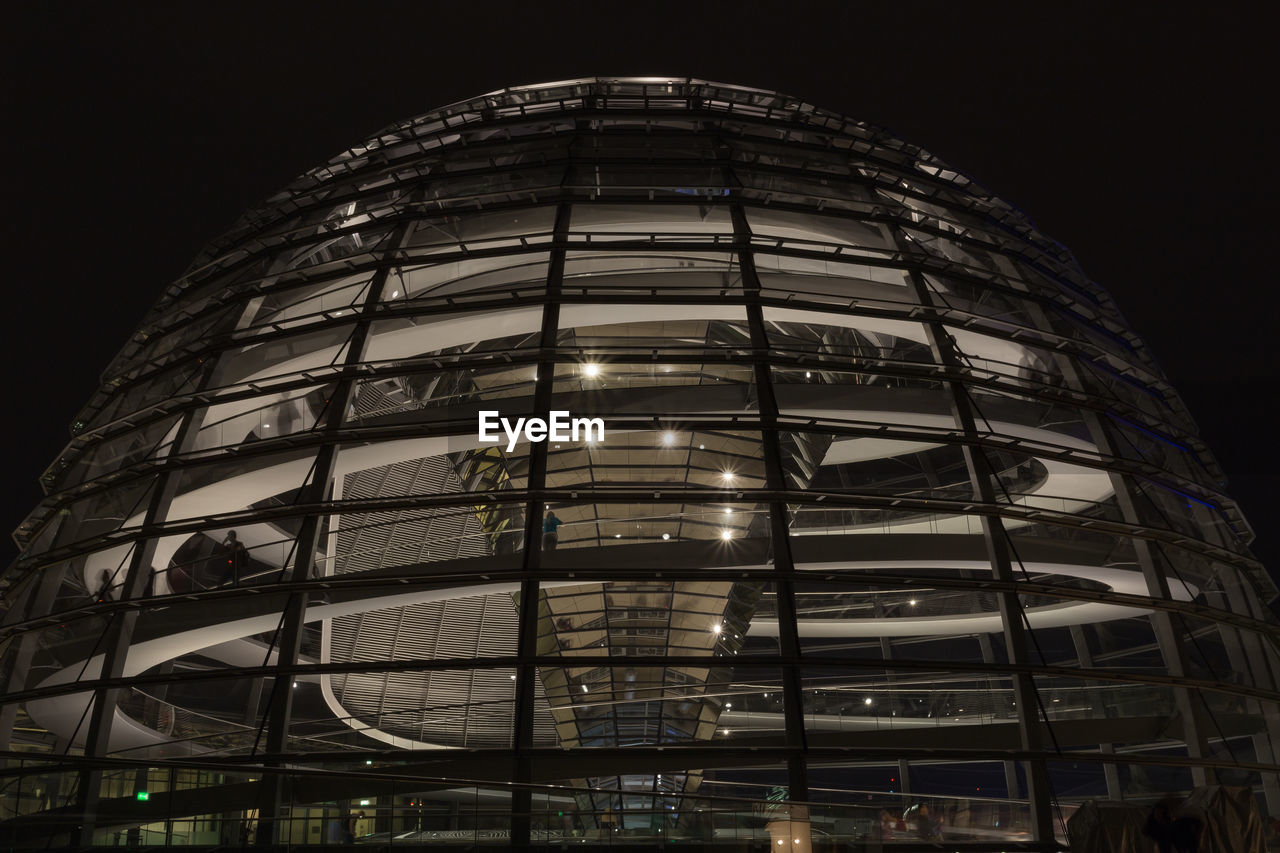 built structure, architecture, low angle view, building exterior, night, glass - material, modern, no people, illuminated, city, sky, reflection, building, outdoors, nature, office building exterior, travel destinations, office, skyscraper
