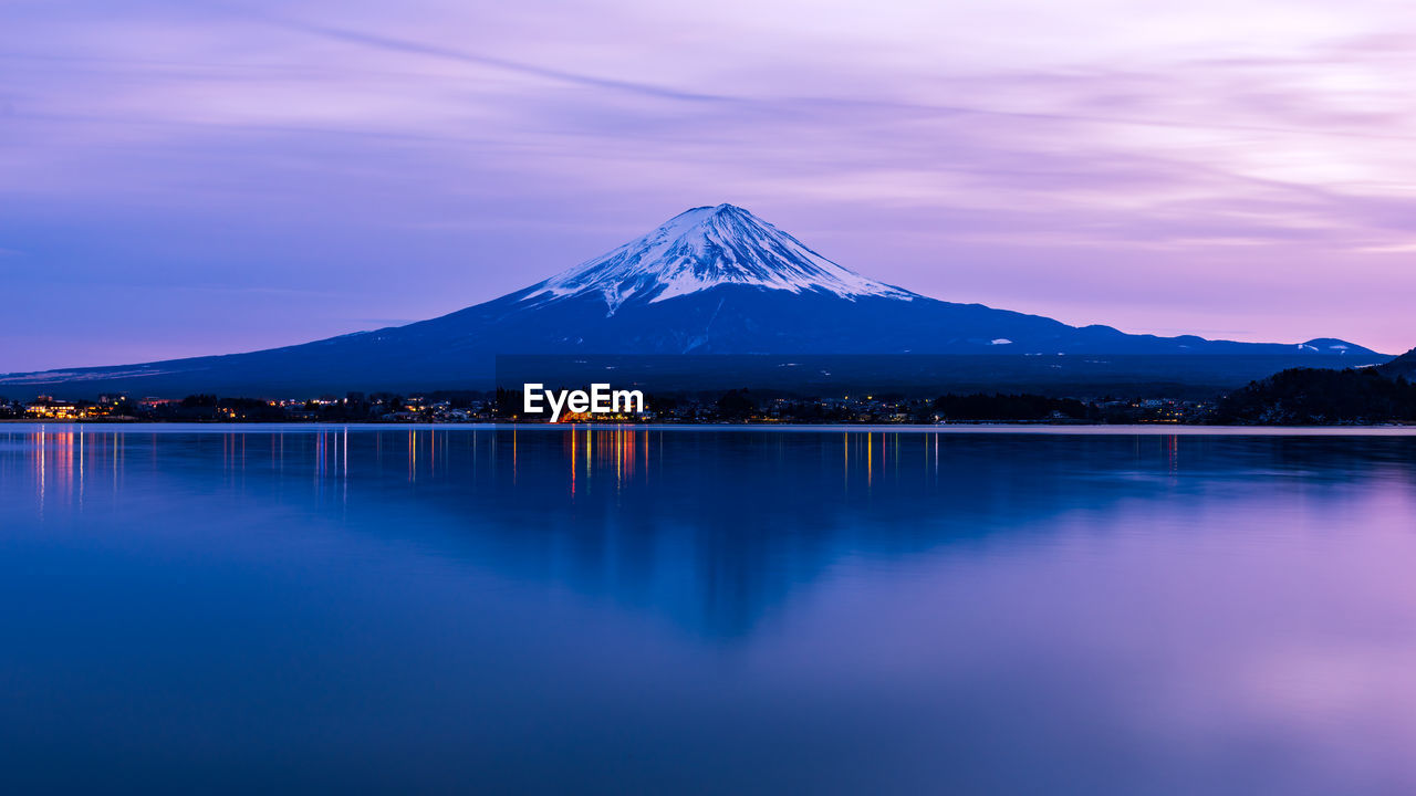 Scenic View Of Lake And Mt Fuji Against Sky During Sunset