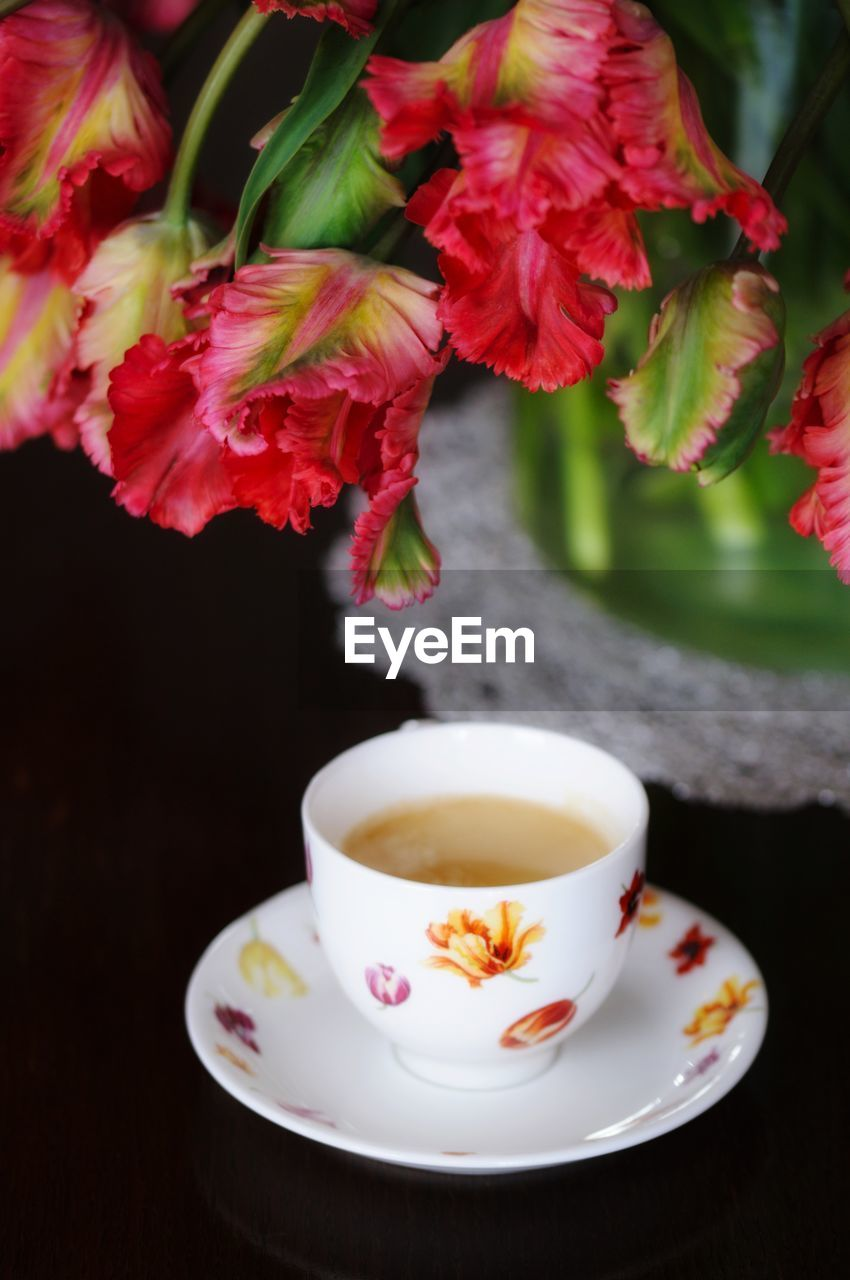 cup, food and drink, drink, mug, refreshment, saucer, freshness, crockery, hot drink, tea, flowering plant, plant, tea - hot drink, flower, table, no people, coffee, close-up, tea cup, coffee - drink, floral pattern, non-alcoholic beverage