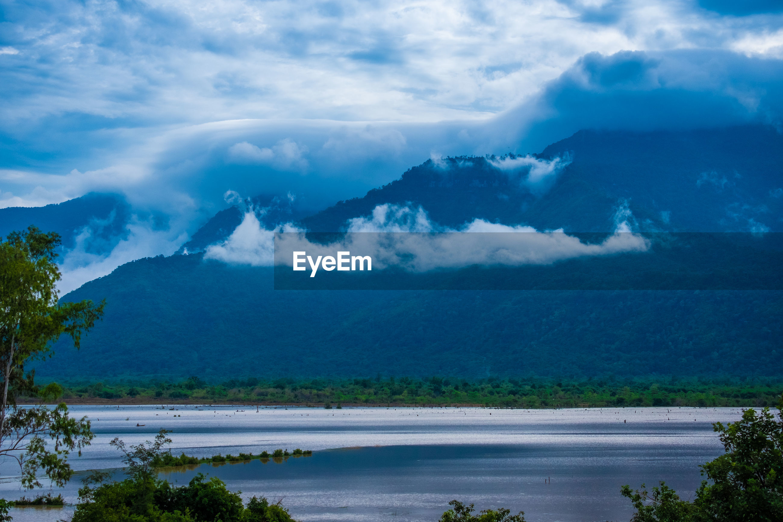 SCENIC VIEW OF MOUNTAINS AND CLOUDS