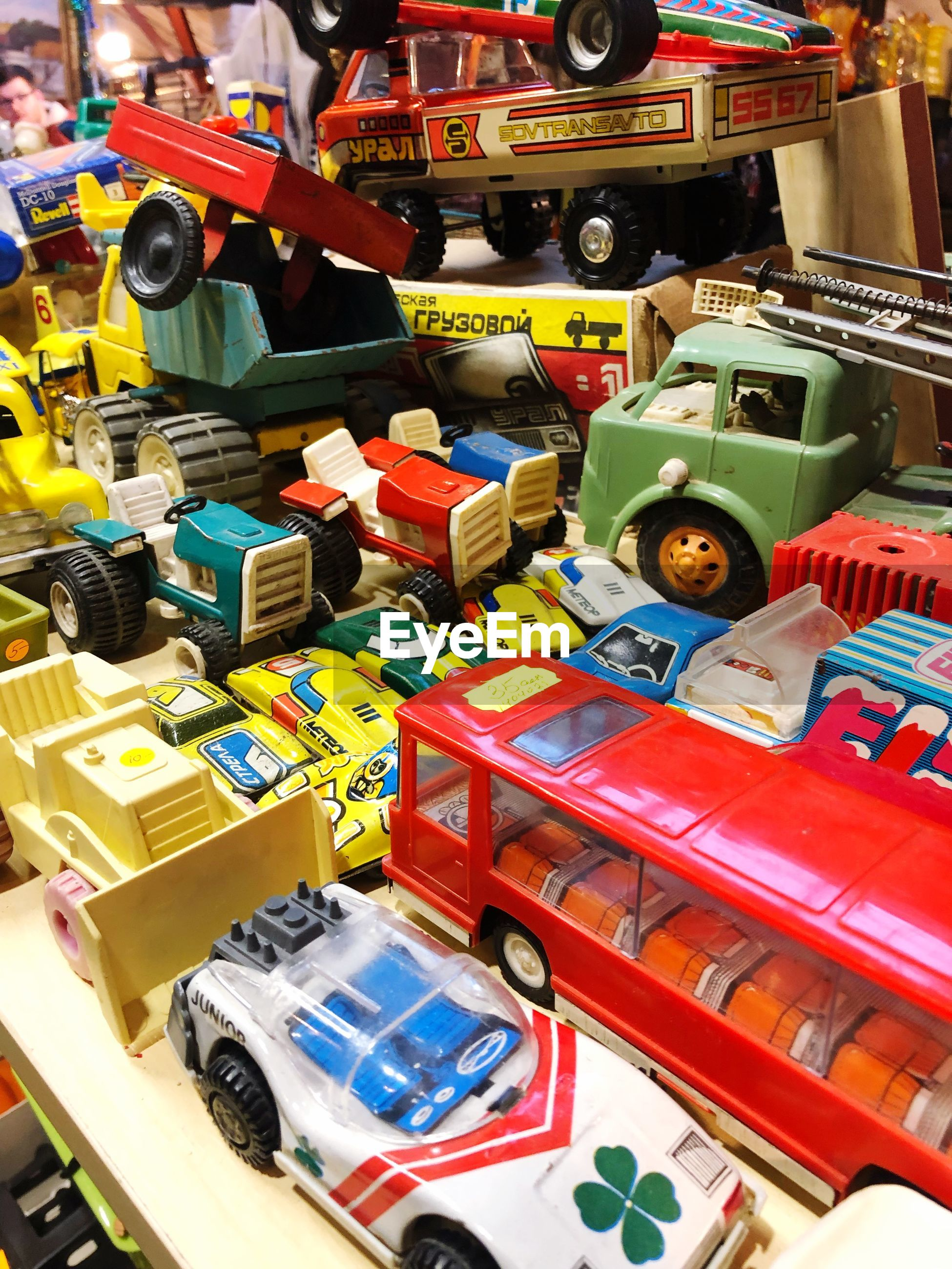 HIGH ANGLE VIEW OF TOY CAR AT MARKET