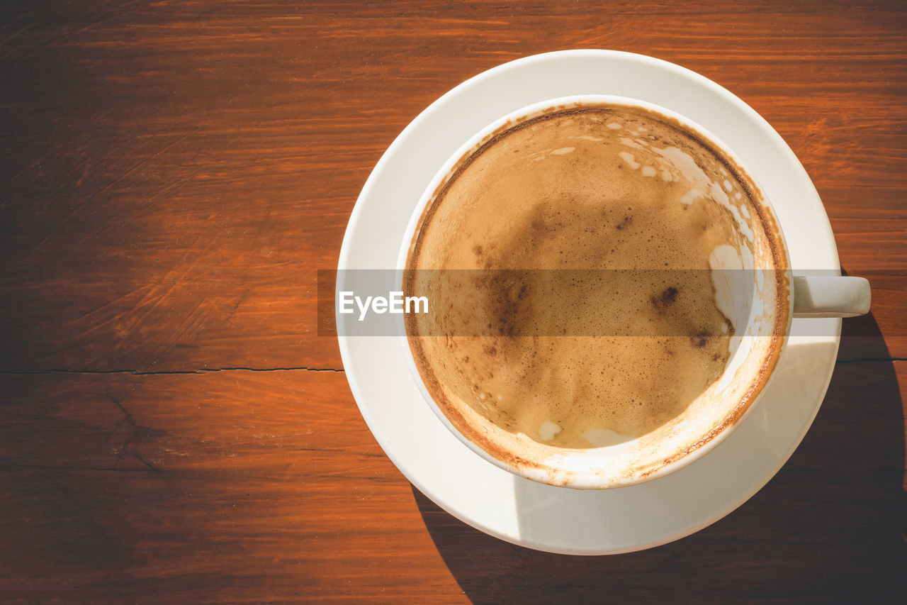 High angle view of coffee on wooden table