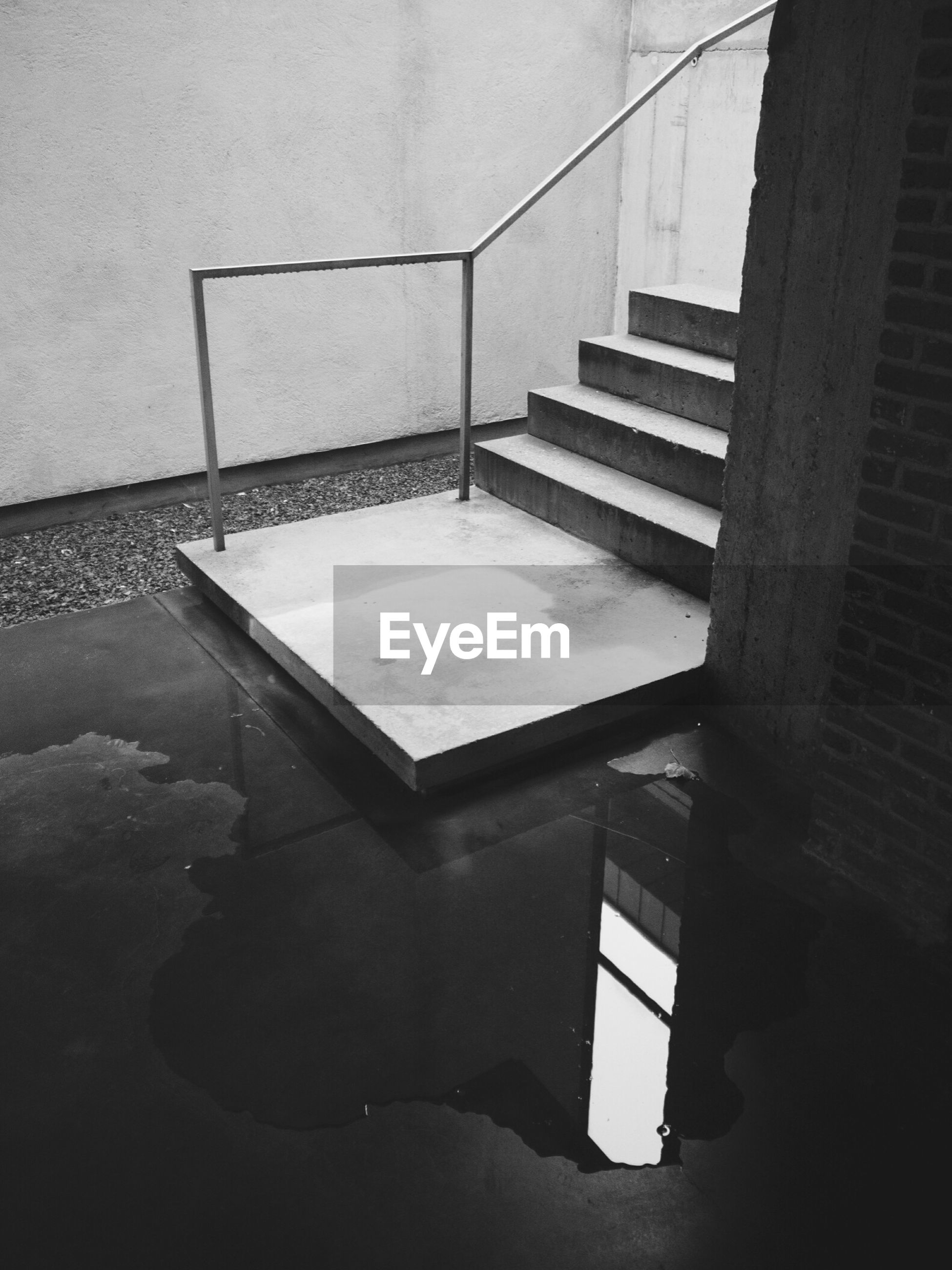 High angle view of water with reflection at stairway