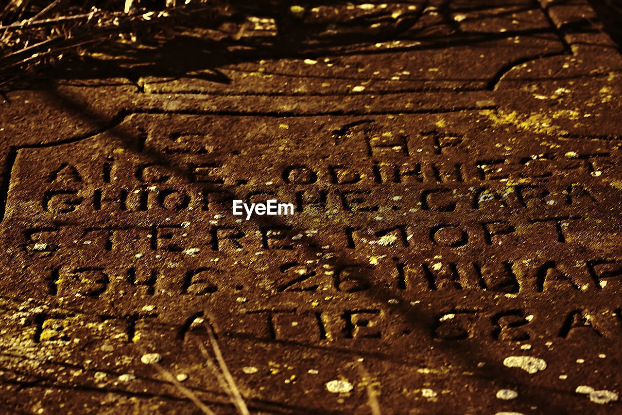 text, full frame, no people, close-up, day, history, communication, textured, backgrounds, outdoors, gravestone