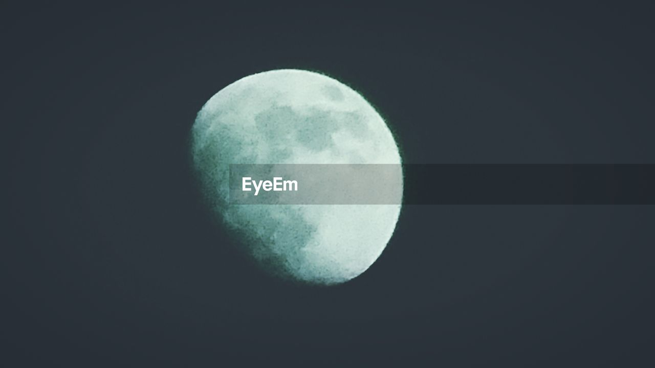 moon, night, moon surface, beauty in nature, nature, astronomy, planetary moon, tranquility, scenics, tranquil scene, half moon, clear sky, idyllic, outdoors, no people, space exploration, discovery, low angle view, space, sky, crescent, close-up