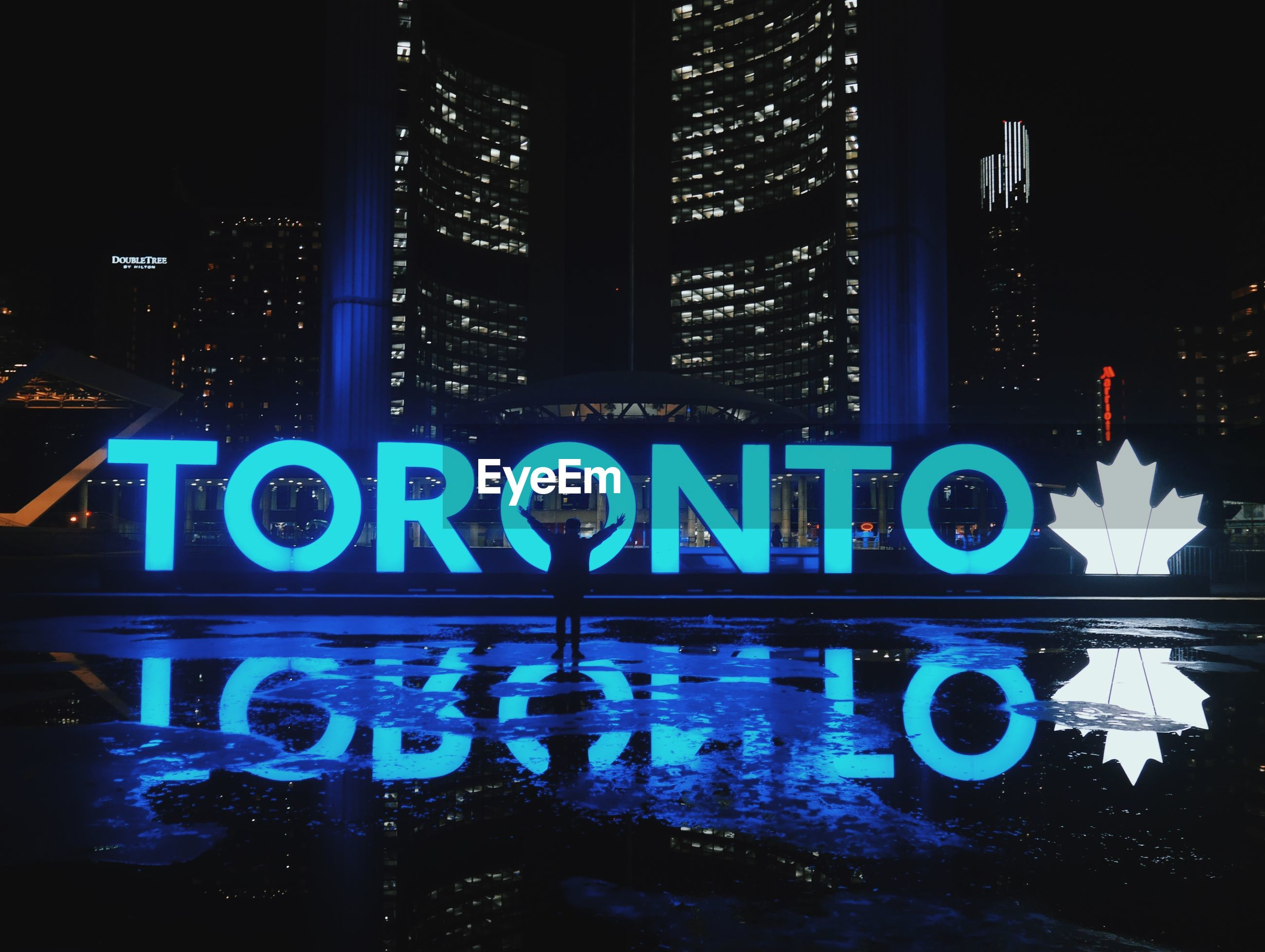 Man in front of toronto sign