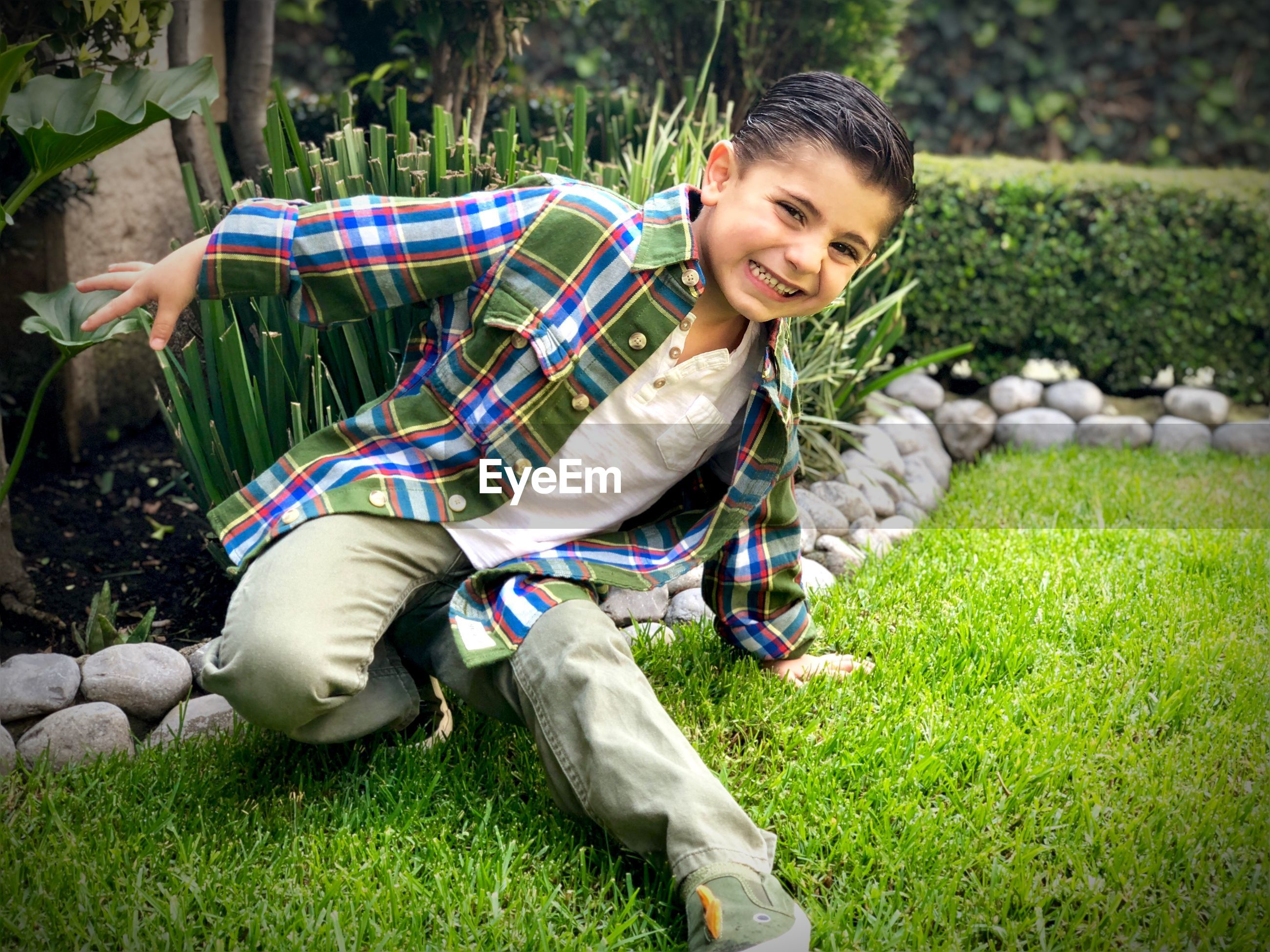 Portrait of smiling boy playing on field
