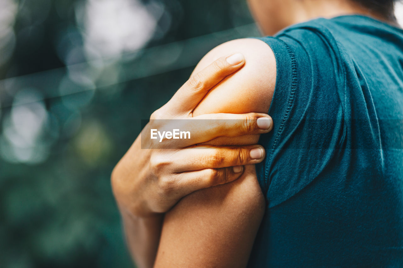 hand, human hand, human body part, real people, focus on foreground, lifestyles, midsection, people, body part, close-up, casual clothing, leisure activity, togetherness, women, bonding, day, positive emotion, adult, two people, couple - relationship, finger, human limb