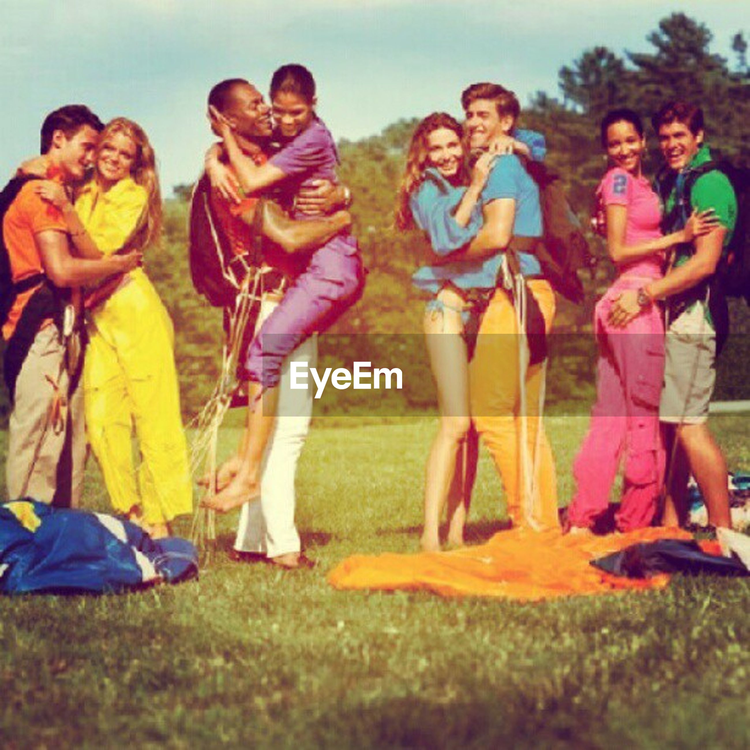 togetherness, leisure activity, lifestyles, childhood, bonding, fun, boys, enjoyment, love, casual clothing, girls, friendship, happiness, elementary age, playful, family, men, full length