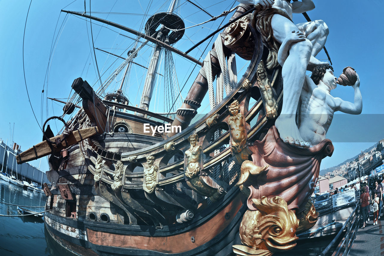 statue, nautical vessel, sculpture, sky, low angle view, mast, outdoors, transportation, no people, day, tall ship, sailing ship