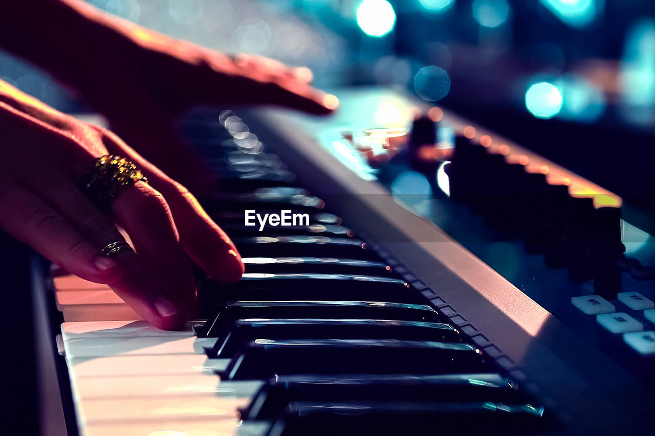 Close-Up Of Musician Playing Piano
