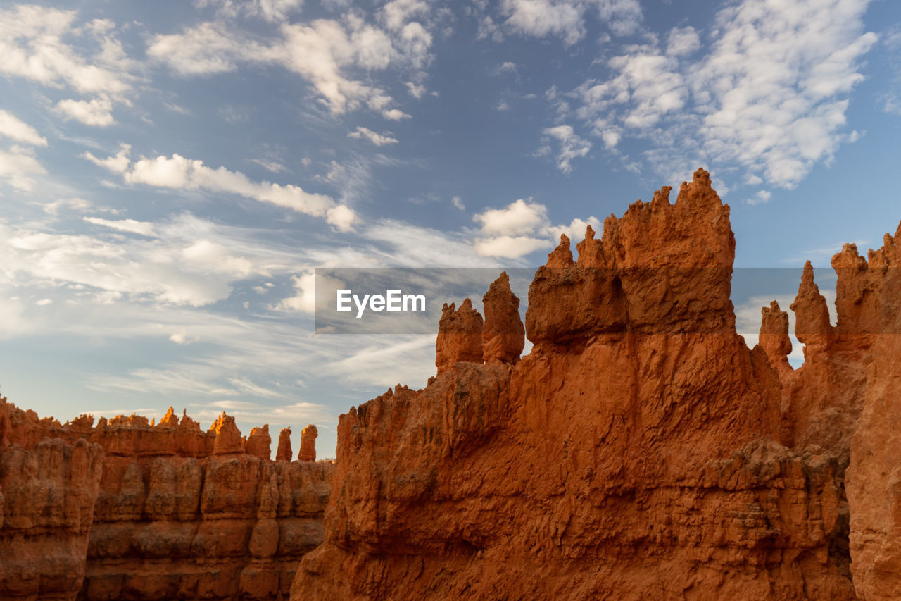 cloud - sky, sky, rock, rock formation, rock - object, nature, the past, history, travel destinations, scenics - nature, no people, day, solid, architecture, beauty in nature, travel, low angle view, tourism, tranquil scene, tranquility, eroded, ancient civilization, formation