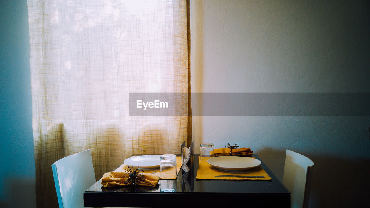 Empty Chairs By Dining Table At Home