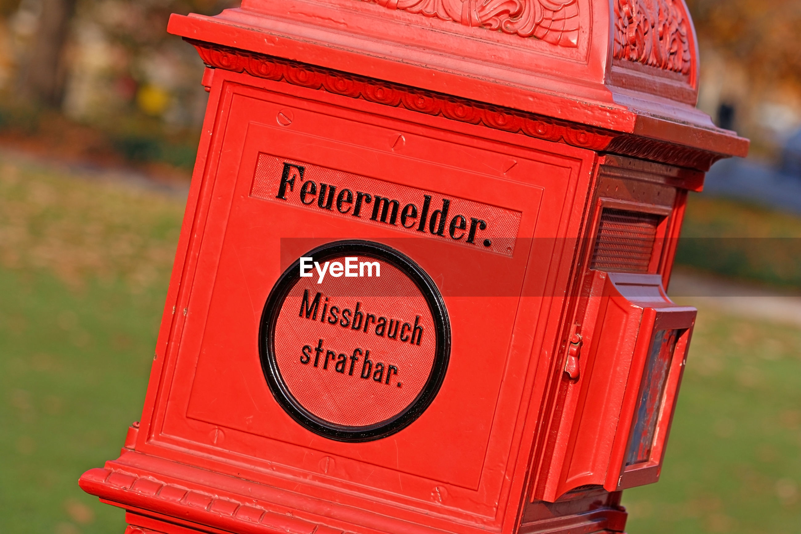 Close-up of text on red mailbox