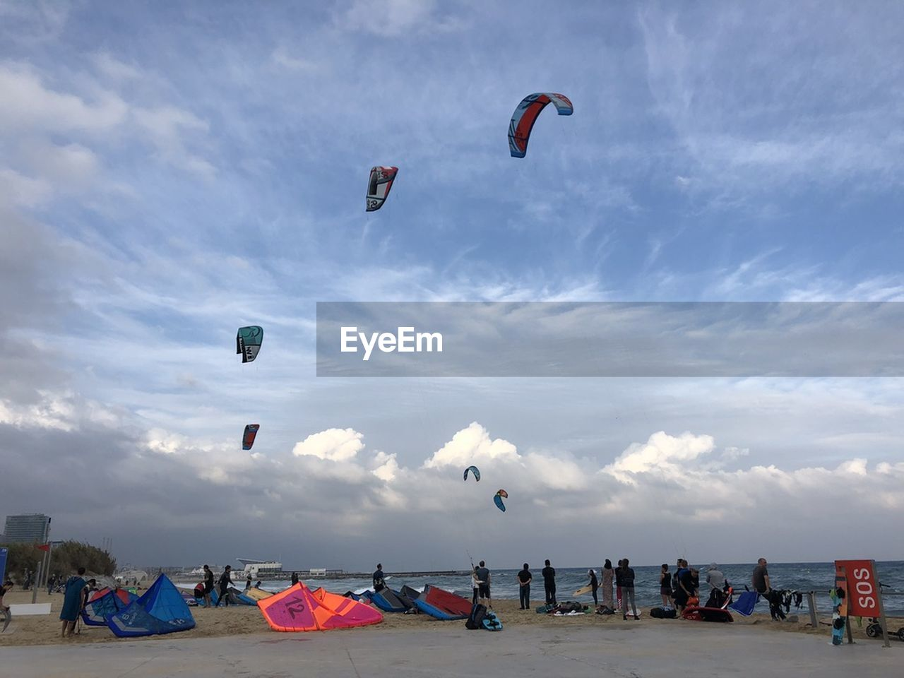 sky, group of people, cloud - sky, real people, adventure, leisure activity, sport, crowd, lifestyles, large group of people, extreme sports, parachute, nature, day, flying, holiday, land, vacations, trip, outdoors, kiteboarding