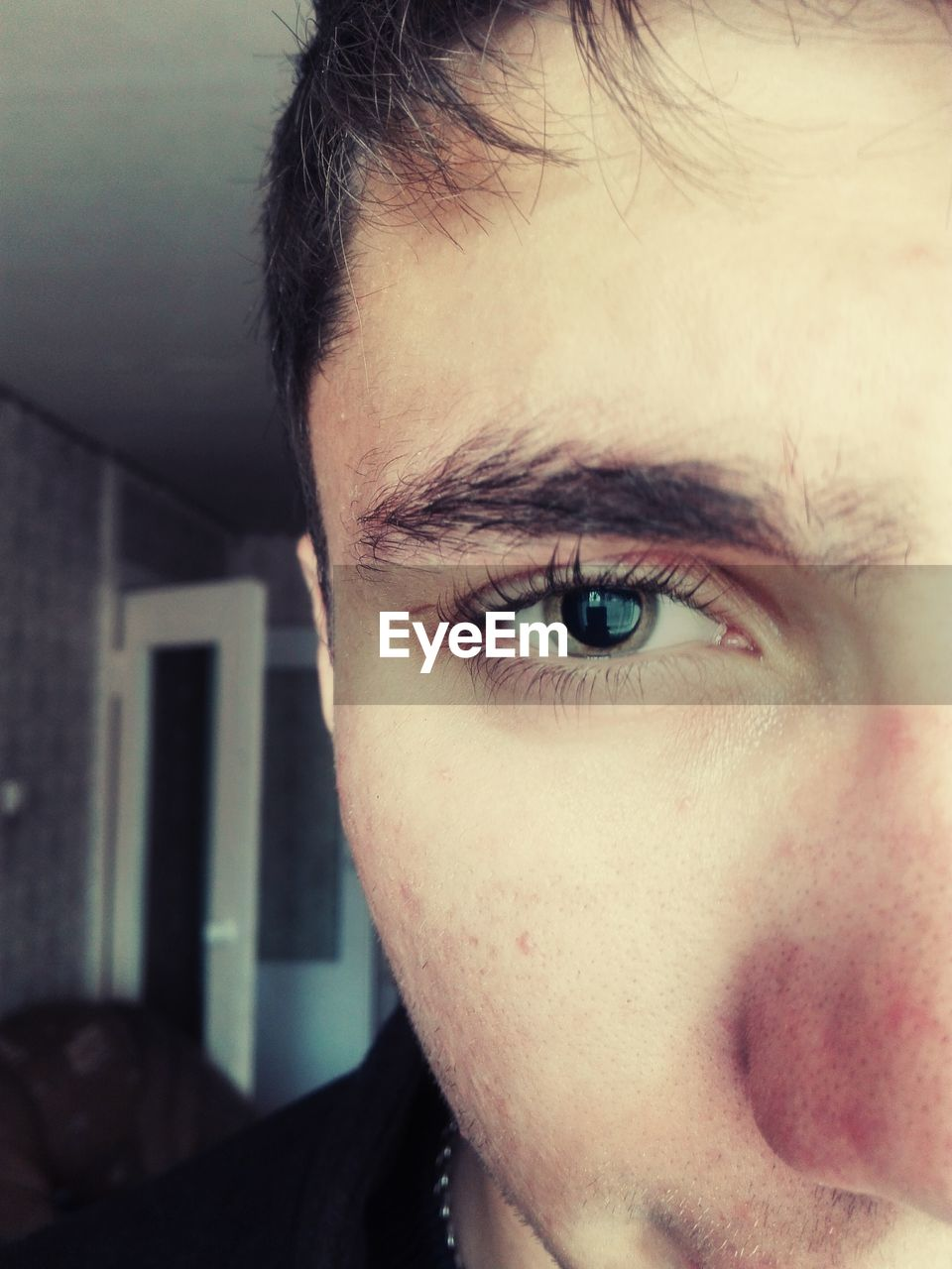looking at camera, real people, one person, portrait, human eye, close-up, human face, front view, young men, indoors, headshot, lifestyles, young adult, human body part, day, eyeball