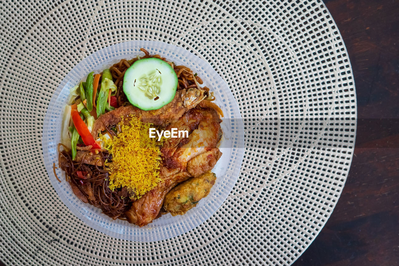 Nasi ambeng or nasi ambang. consists of steamed white rice, chicken stewed in soy sauce