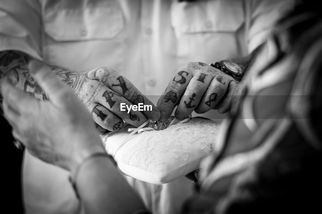 human hand, hand, real people, two people, selective focus, human body part, women, people, indoors, adult, men, midsection, togetherness, lifestyles, body part, love, positive emotion, close-up, holding, bonding, finger, care