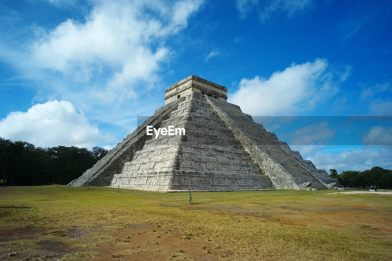 history, the past, architecture, sky, ancient, cloud - sky, ancient civilization, built structure, travel destinations, pyramid, tourism, travel, nature, archaeology, field, building exterior, day, place of worship, no people, outdoors