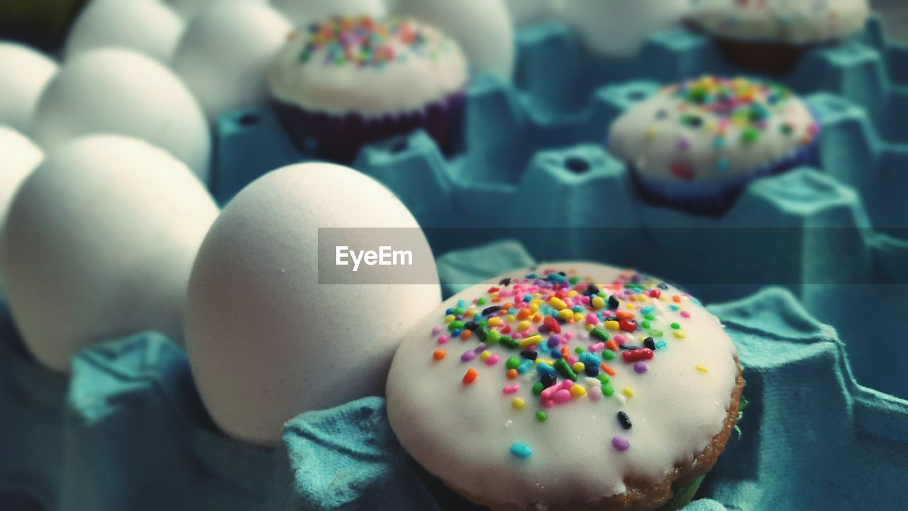 Close-Up Of Cupcake With Eggs In Crate