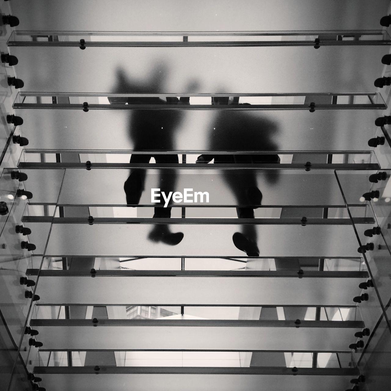 Directly below of people walking down stairs