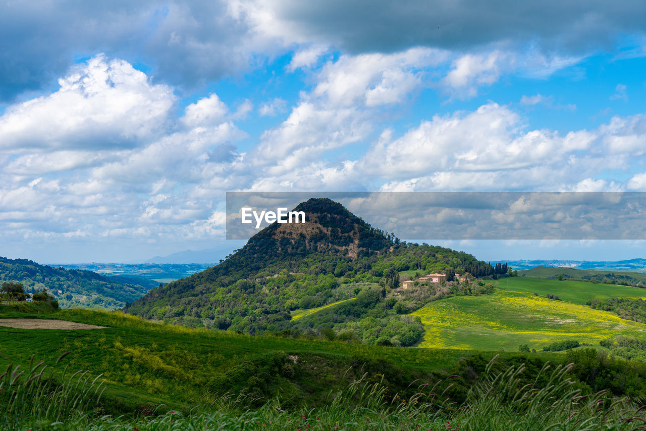 cloud - sky, scenics - nature, sky, mountain, landscape, tranquil scene, beauty in nature, environment, tranquility, plant, grass, green color, non-urban scene, nature, land, day, no people, field, idyllic, mountain range, outdoors, mountain peak, rolling landscape